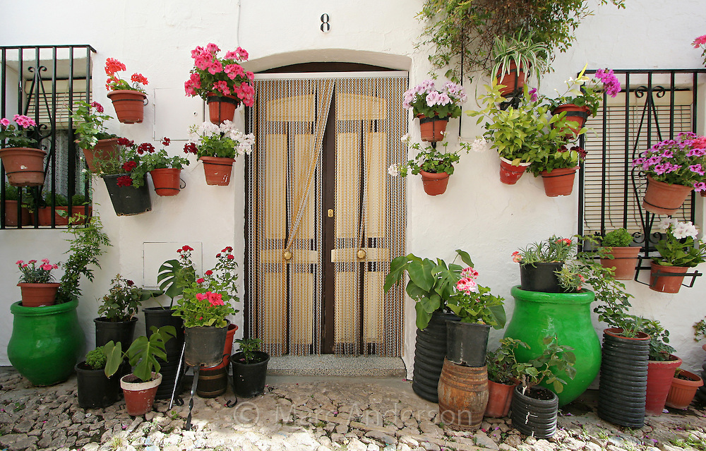 A typical Spanish village house with flower pots.