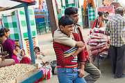 Two young men are hugging while spending a day at the yearly Sonepur Mela, Asia's largest cattle market, in Bihar, India.