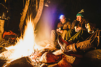 Stough Creek Basin backcountry campfire. Kevin Luby, Kaitlyn Honnold, and Chris Call bring in the night, Wind River Range, Wyoming.