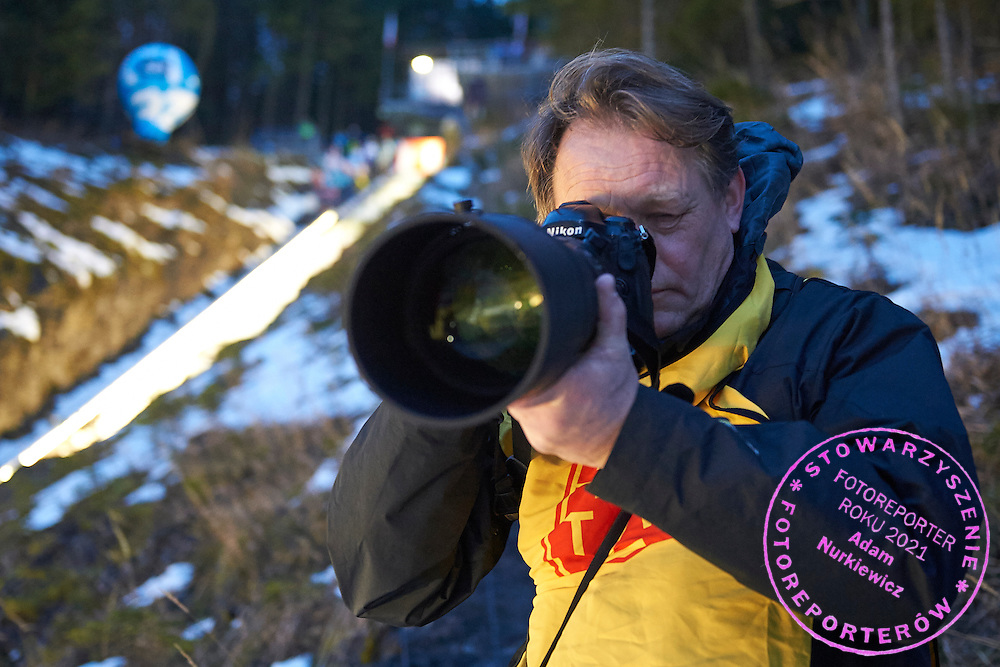 Photographer Janek Skarzynski (Agence France Presse) shoots pictures during FIS World Cup Ski Jumping competition in Zakopane, Poland on January 17, 2015.<br /> <br /> Poland, Zakopane, January 17, 2015.<br /> <br /> Picture also available in RAW (NEF) or TIFF format on special request.<br /> <br /> For editorial use only. Any commercial or promotional use requires permission.<br /> <br /> Mandatory credit:<br /> Photo by &copy; Adam Nurkiewicz / Mediasport