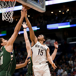 Mar 12, 2019; New Orleans, LA, USA; New Orleans Pelicans guard Frank Jackson (15) shoots over Milwaukee Bucks center Brook Lopez (11) during the second quarter at the Smoothie King Center. Mandatory Credit: Derick E. Hingle-USA TODAY Sports