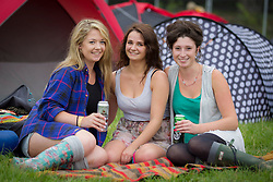 Deirdre Coleman from Dublin, Heather and Hannah Goulbourne from Gorey pictured setting up camp on the opening day of Electric Picnic 2013. Picture Andres Poveda