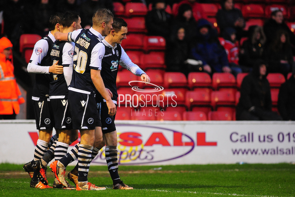 Lee Gregory of Millwall FC is congratulated by his team mates during the Sky Bet League 1 match between Walsall and Millwall at the Banks's Stadium, Walsall, England on 6 February 2016. Photo by Mike Sheridan.