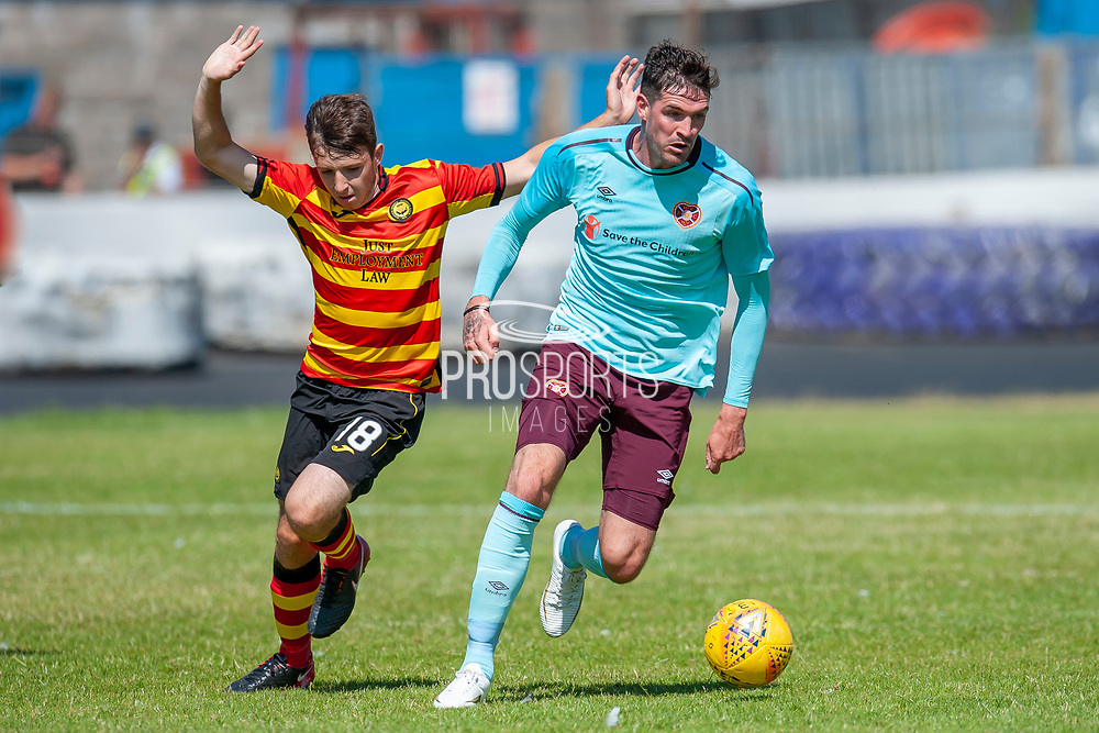 Hearts Kyle Lafferty holds off Partick Thistle's Callum Wilson during the Pre-Season Friendly match between Partick Thistle and Heart of Midlothian at Central Park Stadium, Cowdenbeathl, Scotland on 8 July 2018. Picture by Malcolm Mackenzie.