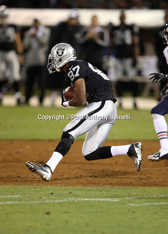 Oakland Raiders wide receiver Tray Session (87) catches a pass in the open field during the NFL preseason week 3 football game against the Chicago Bears on Friday, Aug. 23, 2013 in Oakland, Calif. The Bears won the game 34-26. ©Paul Anthony Spinelli