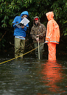 Liberty High School science teacher Gregg Taylor, center, talks to students Jeff Simpson, left, and Scott Hamlin as they gather and record data while standing in the Neversink River in Hasbrouck on Nov. 8, 2006.