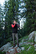 Beñat calls the goats at 5 o'clock in the morning. Brontallo (Switterland) July 03, 2014. Beñat and Nathalie spend two months (July and August) on Spulüi, at 1.900 meters, taking care of goats and making cheese. Their children Kemen (7 years old) and Oihu (18 months) are with them. (Gari Garaialde / Bostok Photo)