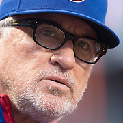 Manager Joe Maddon, Chicago Cubs, watching from the dugout wearing his trademark glasses during the New York Mets Vs Chicago Cubs MLB regular season baseball game at Citi Field, Queens, New York. USA. 30th June 2015. Photo Tim Clayton