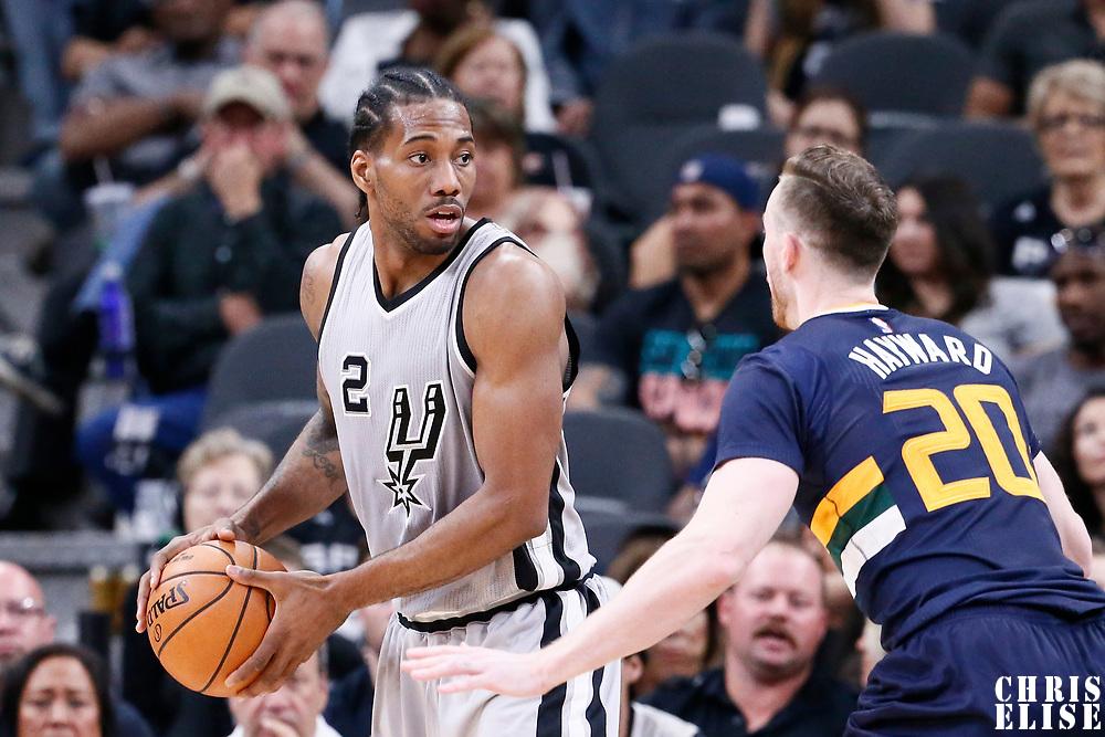 02 April 2017: Utah Jazz forward Gordon Hayward (20) defends on San Antonio Spurs forward Kawhi Leonard (2) during the San Antonio Spurs 109-103 victory over the Utah Jazz, at the AT&T Center, San Antonio, Texas, USA.