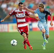 FRISCO, TX - JUNE 22:  Andrew Jacobson #4 of FC Dallas fights for the ball against Chance Myers #7 of Sporting Kansas City on June 22, 2013 at FC Dallas Stadium in Frisco, Texas.  (Photo by Cooper Neill/Getty Images) *** Local Caption *** Andrew Jacobson; Chance Myers