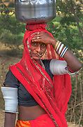 A Bishnoi tribeswoman walks 2km to collect potable water just a few km outside Udaipur.