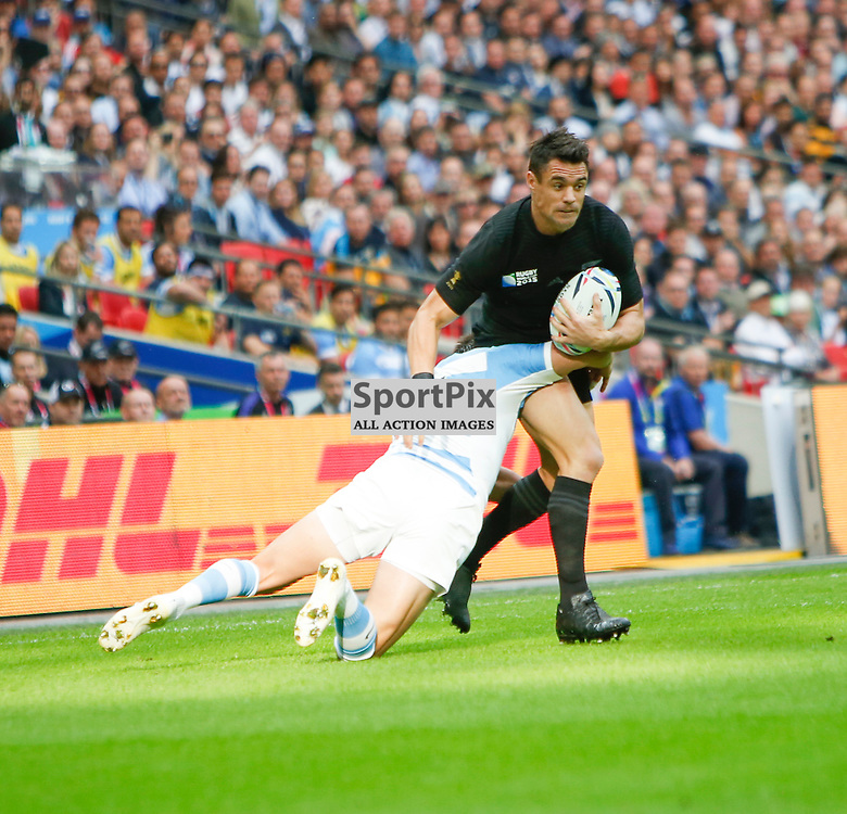 WEMBLEY, ENGLAND - SEPTEMBER 20: Daniel Carter of New Zealand tackled by Juan Imhoff of Argentina during the 2015 Rugby World Cup Pool C match between New Zealand and Argentina at Wembley Stadium on September 20, 2015 in London, England. (Credit: SAM TODD | SportPix.org.uk)