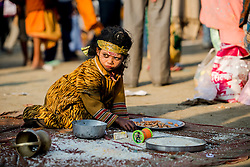 Among the masses that attend the Kumbh Mela are countless homeless and sick that receive handout by pilgrims passing through.