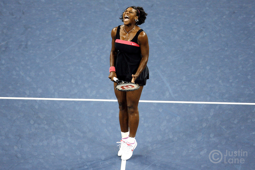 Serena Williams reacts to a missed shot to Justine Henin during the 2007 US Open tennis tournament.
