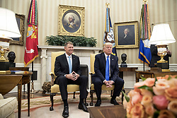 June 9, 2017 - Washington, District of Columbia, United States of America - US President DONALD J. TRUMP (R) and President of Romania KLAUS IOHANNIS (L) meet in the Oval Office of the White House. (Credit Image: © Michael Reynolds/Pool/CNP via ZUMA Wire)