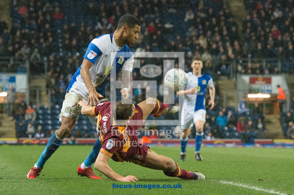 Stephen Warnock of Bradford City with a clearance ahead of Dominic Samuel of Blackburn Rovers during the Sky Bet League 1 match at Ewood Park, Blackburn<br /> Picture by Matt Wilkinson/Focus Images Ltd 07814 960751<br /> 29/03/2018