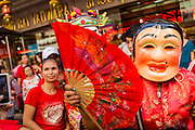 31 JANUARY 2014 - BANGKOK, THAILAND:   Members of a Chinese Lion dance troupe on Yaowarat Road during Lunar New Year festivities, also know as Tet and Chinese New Year, in Bangkok. This year is the Year of the Horse. The Lion Dance scares away evil spirits and brings prosperity and luck. Ethnic Chinese make up about 14% of Thailand and Chinese holidays are widely celebrated in Thailand.     PHOTO BY JACK KURTZ
