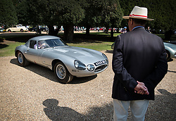 © Licensed to London News Pictures. 02/09/2017. London, UK. An official looks at a 1964 Jaguar Lindner-Nocker Low-drag Lightweight  E-Type displayed at the Concours of Elegance show in the grounds of Hampton Court Palace. The Concours of Elegance brings together, over three days, a selection of 60 of the rarest cars from around the world some of which have never been seen before in the UK. Each car owner is asked to vote on the other models on display to decide which car is considered to be the 'Best of Show'. The show also displays of hundreds of other fine motor cars, including entrants to The Club Trophy. Photo credit: Peter Macdiarmid/LNP