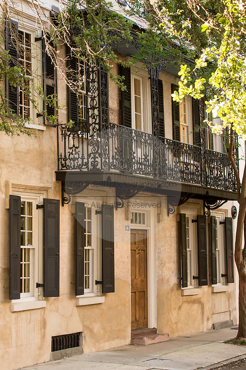 Historic home with decorative ironwork on Church Street in Charleston, SC.