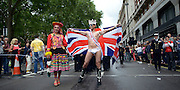 © Licensed to London News Pictures. 07/07/2012. London, UK Guests at the World Pride Procession in Central London today 7th July 2012. Despite reports of it's cancellation due to financial difficulty the scaled-down event went ahead after changes to its schedule. Photo credit : Stephen Simpson/LNP