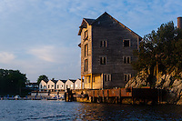 Norway, Stavanger, Hundvåg. Kayaking. Old building at sunset.