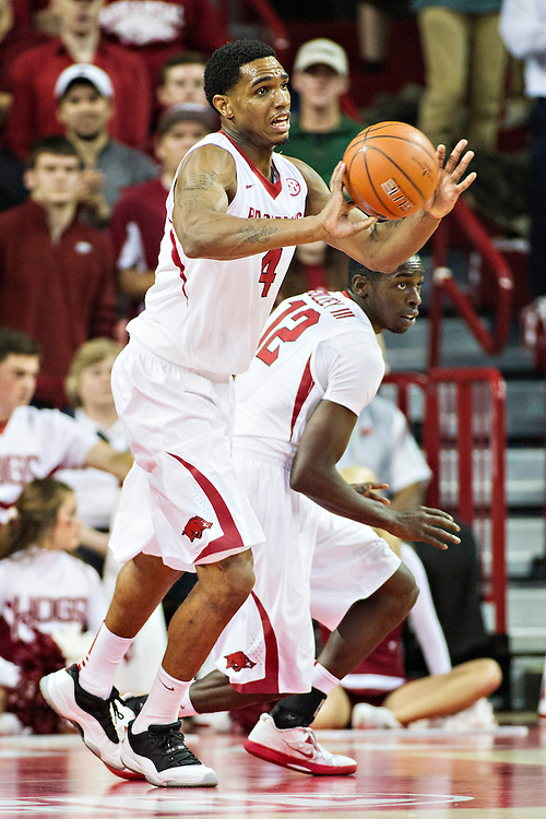 FAYETTEVILLE, AR - NOVEMBER 18:  Coty Clarke #4 of the Arkansas Razorbacks makes a pass against the SMU Mustangs at Bud Walton Arena on November 18, 2013 in Fayetteville, Arkansas.  The Razorbacks defeated the Mustangs 89-78.  (Photo by Wesley Hitt/Getty Images) *** Local Caption *** Coty Clarke