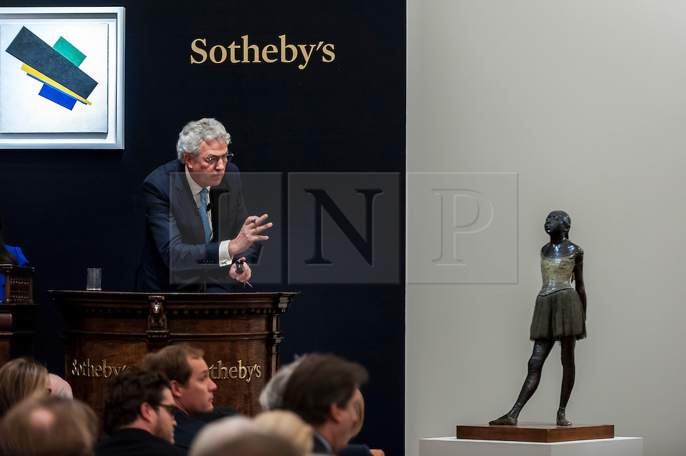 """© Licensed to London News Pictures. 24/06/2015. London, UK. The Sotheby's auctioneer manages bids for Edgar Degas' """"Petite danseuse de quartorze ans"""" which sold for a hammer price of £14m, £2m more than its estimate of £12m. Sotheby's Impressionist & Modern art evening sale realised a total of £178.6m, the second highest total for any sale ever held in London. Photo credit : Stephen Chung/LNP"""