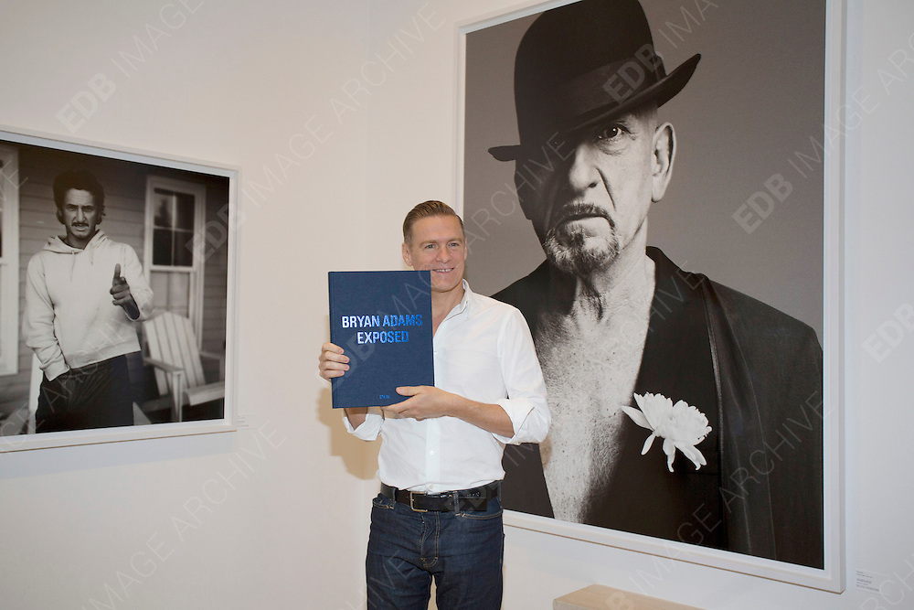 01.OCTOBER.2012. HAMBURG<br /> <br /> BRYAN ADAMS PRESENTS HIS BOOK EXPOSED DURING AN EXHIBITION OF HIS PHOTOGRAPHIC WORK AT THE CROSSOVER SHOWROOM IN HAMBURG, GERMANY.<br /> <br /> BYLINE: EDBIMAGEARCHIVE.CO.UK<br /> <br /> *THIS IMAGE IS STRICTLY FOR UK NEWSPAPERS AND MAGAZINES ONLY*<br /> *FOR WORLD WIDE SALES AND WEB USE PLEASE CONTACT EDBIMAGEARCHIVE - 0208 954 5968*