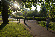 As the UK government's Coronavirus pandemic lockdown continues, and <br /> a further 823 people have died in hospitals across the UK in a day, taking the total to 17,337, Londoners practice social distancing during their daily exercise in late afternoon in Rsukin Park, a public green space in the borough of Lambeth, on 21st April 2020, in London, England.