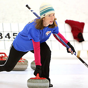 Maggie Schaber delivers a stone during a curling match at the Wilmington Ice House. (Jason A. Frizzelle)