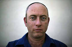 "Yuda Gross, 46, a shopkeeper and resident of the Gush Katif settlements, is seen in Gaza, Palestinian Territories, Nov. 4, 2004. When asked his thoughts about leaving the settlements Gross responded, ""I feel strong and that the truth is with me. If you believe you are right, everything will continue."" Israel's parliament recently supported compensation payments for Jewish settlers leaving the Gaza Strip, in a vital vote for Prime Minister Ariel Sharon's plan to evacuate the occupied territory."