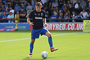 AFC Wimbledon defender Ben Purrington (3) warming up during the EFL Sky Bet League 1 match between AFC Wimbledon and Scunthorpe United at the Cherry Red Records Stadium, Kingston, England on 15 September 2018.