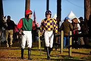 Colonial Cup - Camden, South Carolina. Jockeys walk to the paddock for a race.