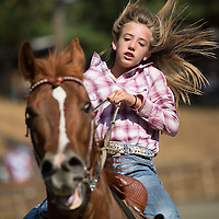 A barrel racing contestant sprints to the finish line during the rodeo.