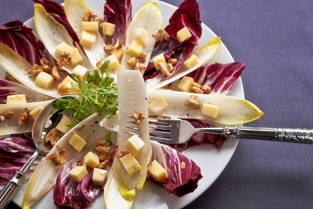 Chicory salad with yellow chicory,red chicory, walnuts, mountain cheese and watercress, served with a lemon-sour cream dressing.