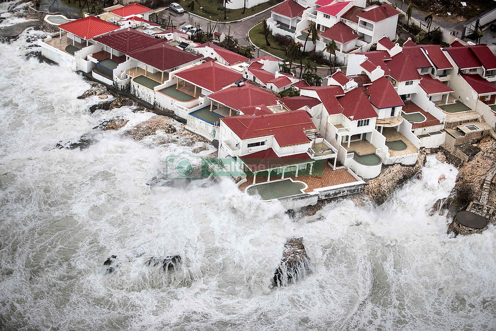 September 6, 2017 - Philipsburg, St Maarten - An aerial photograph provided by the Dutch Ministry of Defense shows the damage of Hurricane Irma on the Caribbean island of St. Maarten. Storm surge and waves lash a resort on the Dutch Island of St. Maarten following a direct hit by Hurricane Irma, a Category 5 storm lashing the Caribbean. Imra is packing winds of 185-mph making it the strongest hurricane ever recorded in the Atlantic Ocean. (Credit Image: © Gerben Van Es/Dutch Ministry of Defense/Planet Pix via ZUMA Wire)
