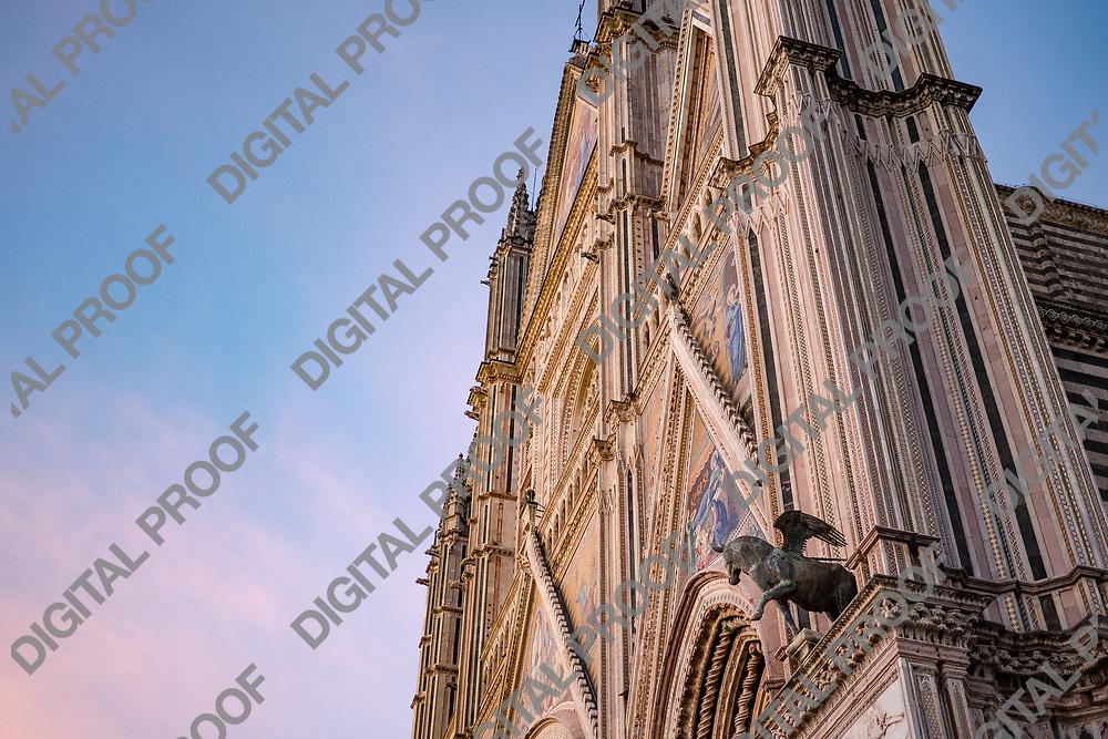 Facade Duomo di Orvieto at sunset