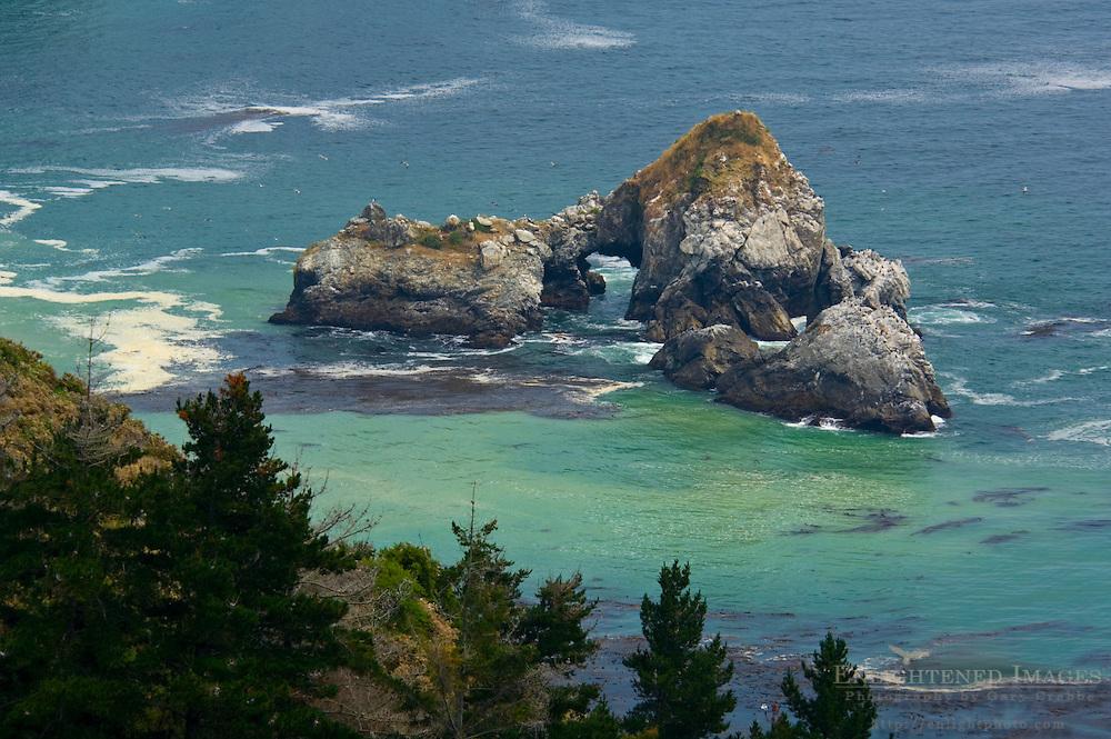 Offshore rock sea stacks in green ocean water along the Big Sur Coast, Monterey County, California