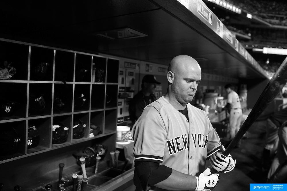 Brian McCann, New York Yankees, in the dugout preparing to bat during the New York Mets Vs New York Yankees MLB regular season baseball game at Citi Field, Queens, New York. USA. 20th September 2015. Photo Tim Clayton