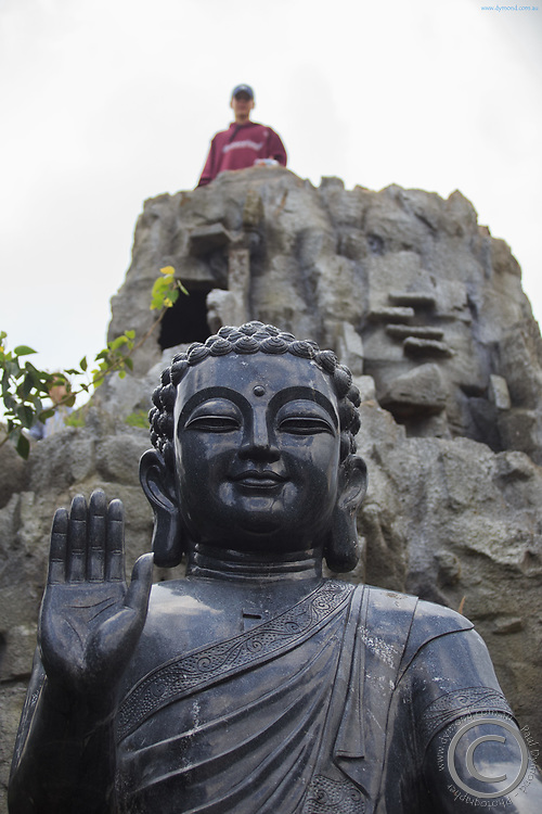 A black Buddha statue within the grounds of the Linh Ung Pagoda, Da Nang, Vietnam