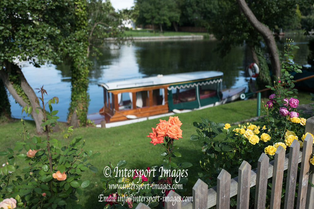 "Maidenhead, United Kingdom. General view across the course from River Road, roses in full bloom. riversde garden. ""Thames Punting Club Regatta"", Bray Reach.<br />