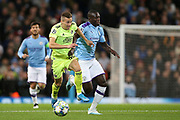 Dinamo Zagreb midfielder Mislav Orsic (99) challenges with Manchester City defender Benjamin Mendy (22) during the Champions League match between Manchester City and Dinamo Zagreb at the Etihad Stadium, Manchester, England on 1 October 2019.