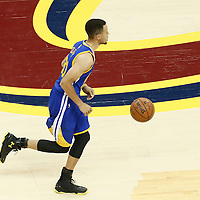10 June 2016: Golden State Warriors guard Stephen Curry (30) brings the ball up court during the Golden State Warriors 108-97 victory over the Cleveland Cavaliers, during Game Four of the 2016 NBA Finals at the Quicken Loans Arena, Cleveland, Ohio, USA.