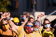 """28 JULY 2020 - DES MOINES, IOWA: Members of Iowa's """"Wall of Moms"""" cheer for Black Lives Matter during a rally before a BLM march in Des Moines. About 150 supporters of Black Lives Matter marched from downtown to Des Moines to the Governor's Mansion. They were demanding that Iowa Governor Kim Reynolds restore the voting rights for felons who have completed their sentence. In June, Reynolds met with representatives of Black Lives Matter and promised to sign an executive order to restore voting rights, but she hasn't said anything more about it in six weeks. Iowa is now the only state in the US that permanently strips felons of their voting rights. That means 60,000 people in Iowa can't vote.     PHOTO BY JACK KURTZ"""