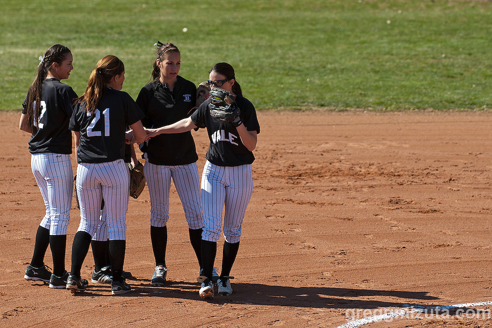 First inning (L to R: Hannah Mizuta, Jaylene Tolman, Amanda Trenkel, McKenna Hawley, Sasha Morcom) meeting at the pitchers mound during the Vale Payette softball game, March 22, 2014 at Payette, Idaho.
