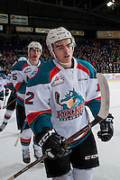 KELOWNA, CANADA - FEBRUARY 1: Erik Gardiner #12 of the Kelowna Rockets skates to the bench to celebrate a goal against the Calgary Hitmen on February 1, 2017 at Prospera Place in Kelowna, British Columbia, Canada.  (Photo by Marissa Baecker/Shoot the Breeze)  *** Local Caption ***