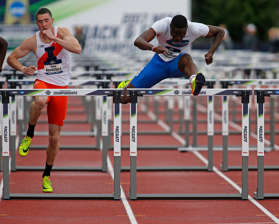 Florida's Grant Holloway clear as hurdle ahead of Illinois' David Kendziera to win the men's 110 meters hurdles on the third day of the NCAA outdoor college track and field championships in Eugene, Ore., Friday, June 9, 2017. Holloway' won in 13.49 seconds, and Kendziera finished third. (AP Photo/Timothy J. Gonzalez)