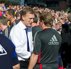LIVERPOOL, ENGLAND - Saturday, October 1, 2011: Liverpool's manager Kenny Dalglish and Everton's manager David Moyes during the Premiership match at Goodison Park. (Pic by David Rawcliffe/Propaganda)