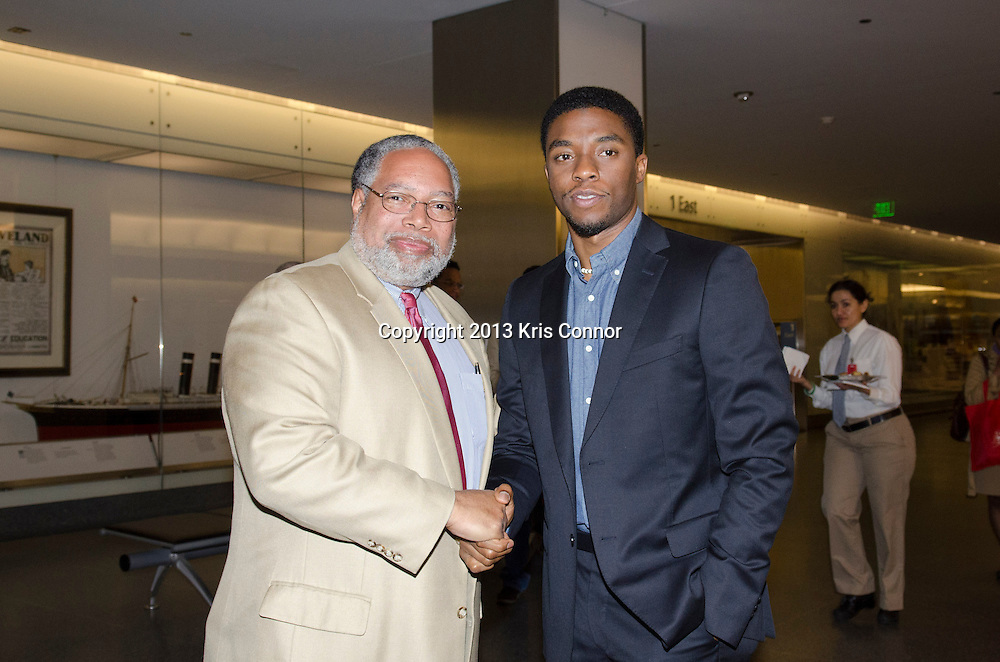 "WASHINGTON, DC - APRIL 15:  Chadwick Boseman, and Lonnie G. Bunch III,  director of the Smithsonian's National Museum of African American History and Culture  pose with Jackie Robinson artifacts during the Washington DC screening of Warner Bro's film ""42"" at Smithsonian Museum of American History on April 15th, 2013. Guests included star of the film Chadwick Boseman, John Gray, Carol Melton, and Lonnie Bunch. Photo by Kris Connor/Warner Bros"