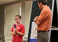 Colter LaFollette (from left), 11, of Mount Vernon explains their class schedule at the beginning of the parents presentation as Mike Wilhelm, of Cedar Rapids looks on during the last Just Right for ME! class at Theatre Cedar Rapids in Cedar Rapids on Saturday, July 14, 2012. Wilhelm was one of the teachers for the class. (Stephen Mally/Freelance)